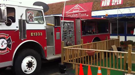 Fire truck sports bar with beer on tap, tv and food on the